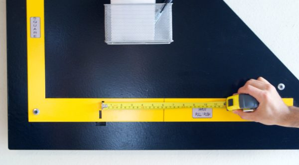 Photo of calibrating by pushing tape measure.